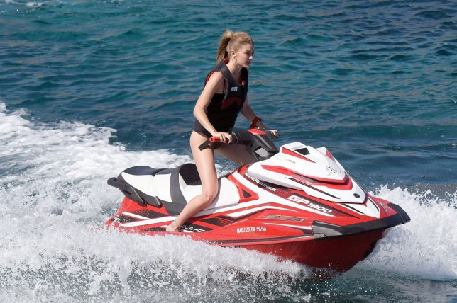 BGUK_1279015 - *PREMIUM-EXCLUSIVE* ** RIGHTS: ONLY UNITED KINGDOM ** MYKONOS, GREECE - *MUST CALL FOR PRICING* American fashion model Gigi Hadid was pictured having fun with a jet ski on Mykonos Island in Greece. Gigi paraded her slender frame wearing a two-toned bikini. The supermodel was all smiles as she enjoyed her day of fun with a female friend, she wore her blonde hair in a ponytail. Pics taken: 02/07/2018 Pictured: Gigi Hadid BACKGRID UK 4 JULY 2018 UK: +44 208 344 2007 / uksales@backgrid.com USA: +1 310 798 9111 / usasales@backgrid.com *UK Clients - Pictures Containing Children Please Pixelate Face Prior To Publication*
