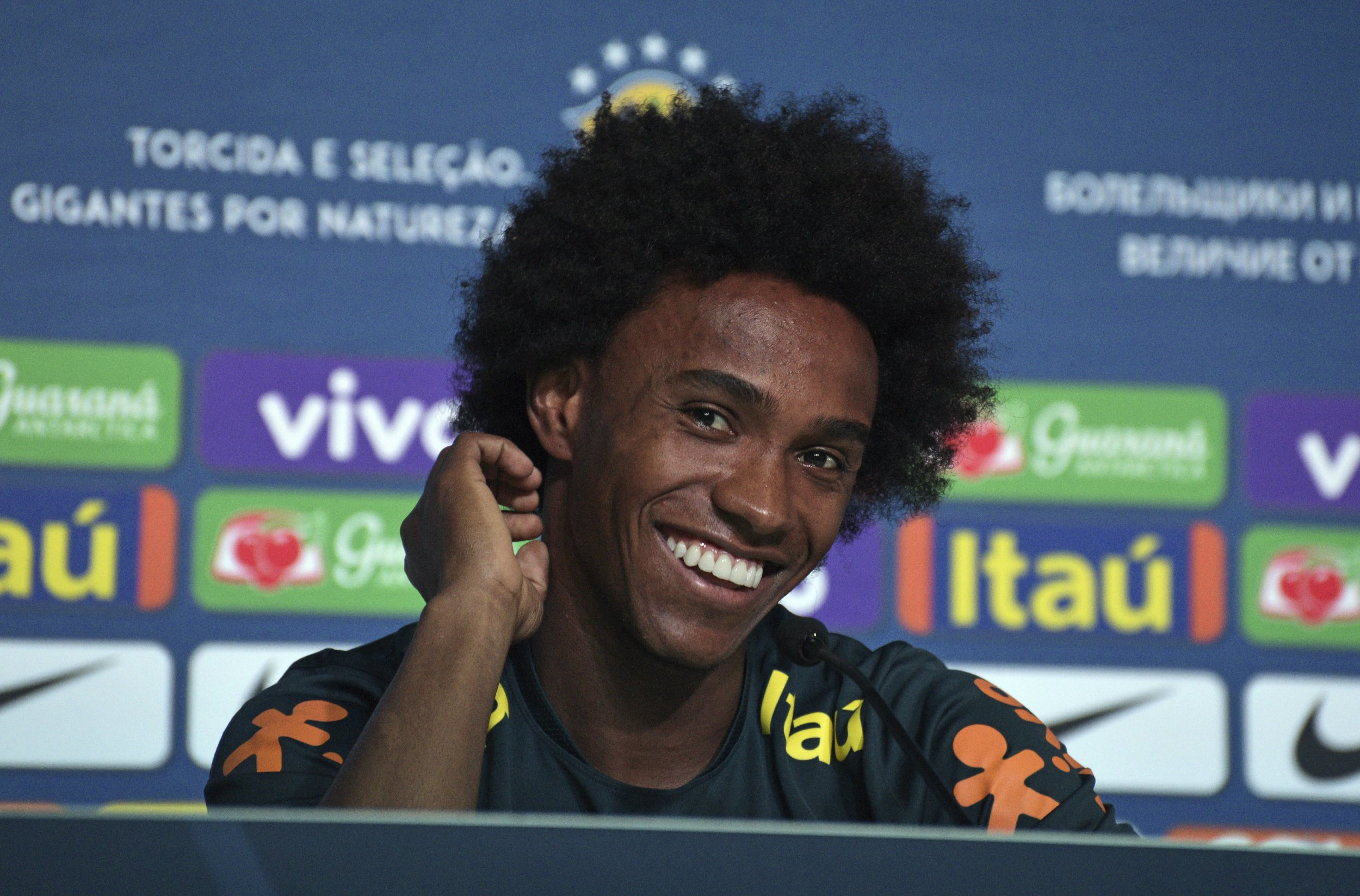 Brazil's Willian smiles during a press conference in Sochi, Russia, Wednesday, July 4, 2018. Brazil will face Belgium on July 6 in the quarterfinals for the soccer World Cup. (AP Photo/Ekaterina Lyzlova)