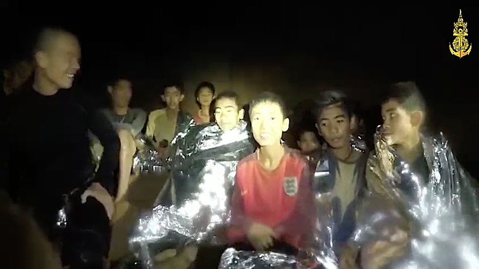 CHIANG RAI, THAILAND - JULY 04: (EDITORIAL USE ONLY. NO SALES. NO ARCHIVING) A video grab handout made available by the Thai Navy SEALs shows some of the members of a soccer team in a section of Tham Luang cave in Khun Nam Nang Non Forest Park on July 04, 2018 in Chiang Rai, Thailand. The 12 boys and their soccer coach have been found alive in the cave where they've been missing for over a week after monsoon rains blocked the main entrance in northern Thailand. Videos released by the Thai Navy SEAL shows the boys, aged 11 to 16, and their 25-year-old coach are in good health in Tham Luang Nang Non cave and the challenge now will be to extract the party safely. (Photo by Thai Navy SEALs via Getty Images)