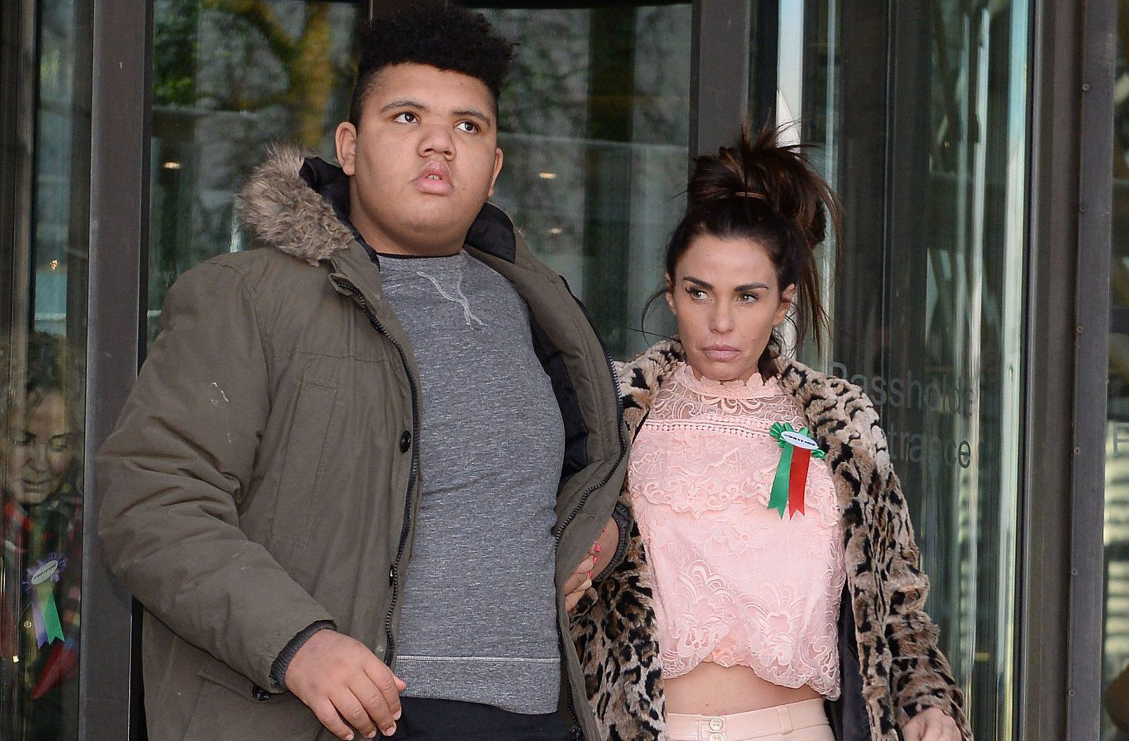 Katie Price with her son Harvey leaves Portcullis House in London after giving evidence to the Commons Petitions Committee where she called for online abuse to be made a specific offence.
