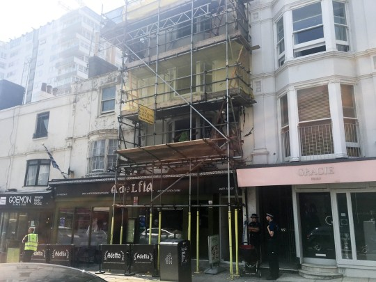 Two men were arrested after timber fell from scaffolding in Brighton onto a three-year-old girl.