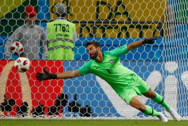 epa06869381 Goalkeeper Alisson of Brazil concedes the 0-2 goal during the FIFA World Cup 2018 quarter final soccer match between Brazil and Belgium in Kazan, Russia, 06 July 2018. (RESTRICTIONS APPLY: Editorial Use Only, not used in association with any commercial entity - Images must not be used in any form of alert service or push service of any kind including via mobile alert services, downloads to mobile devices or MMS messaging - Images must appear as still images and must not emulate match action video footage - No alteration is made to, and no text or image is superimposed over, any published image which: (a) intentionally obscures or removes a sponsor identification image; or (b) adds or overlays the commercial identification of any third party which is not officially associated with the FIFA World Cup) EPA/DIEGO AZUBEL EDITORIAL USE ONLY