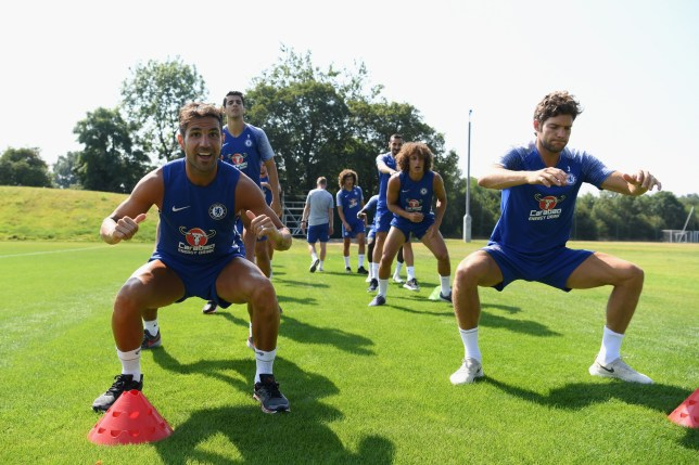COBHAM, ENGLAND - JULY 07: Cesc Fabregas and Marcos Alonso of Chelsea during a training session at Chelsea Training Ground on July 7, 2018 in Cobham, England. (Photo by Darren Walsh/Chelsea FC via Getty Images)
