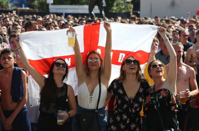 BRISTOL, ENGLAND - JULY 07: England fans celebrate while watching England take on Sweden in the World Cup quarter finals at Ashton Gate World Cup fans village at the Bristol City football club on July 7, 2018 in London, England. Millions of fans will be supporting England today as the quarter-final match kicks off in the Russian city of Samara. England have not reached the last four in a World cup for 28 years with only one World Cup win in 1966. (Photo by Matt Cardy/Getty Images)