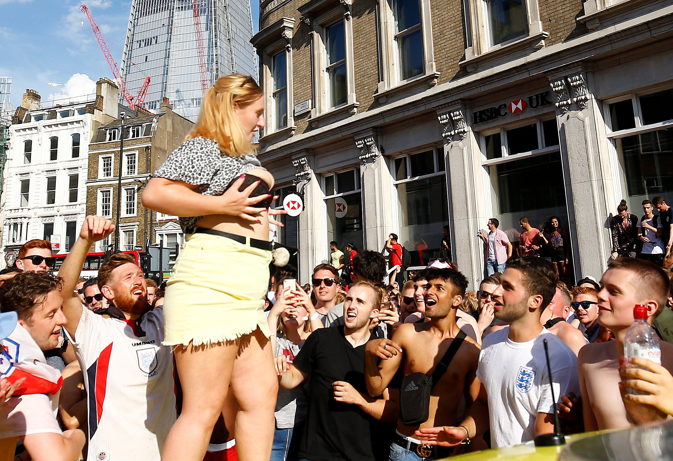 Soccer Football - World Cup - England fans watch Sweden vs England - London, Britain - July 7, 2018 England fan celebrates on top of an ambulance after the match REUTERS/Henry Nicholls