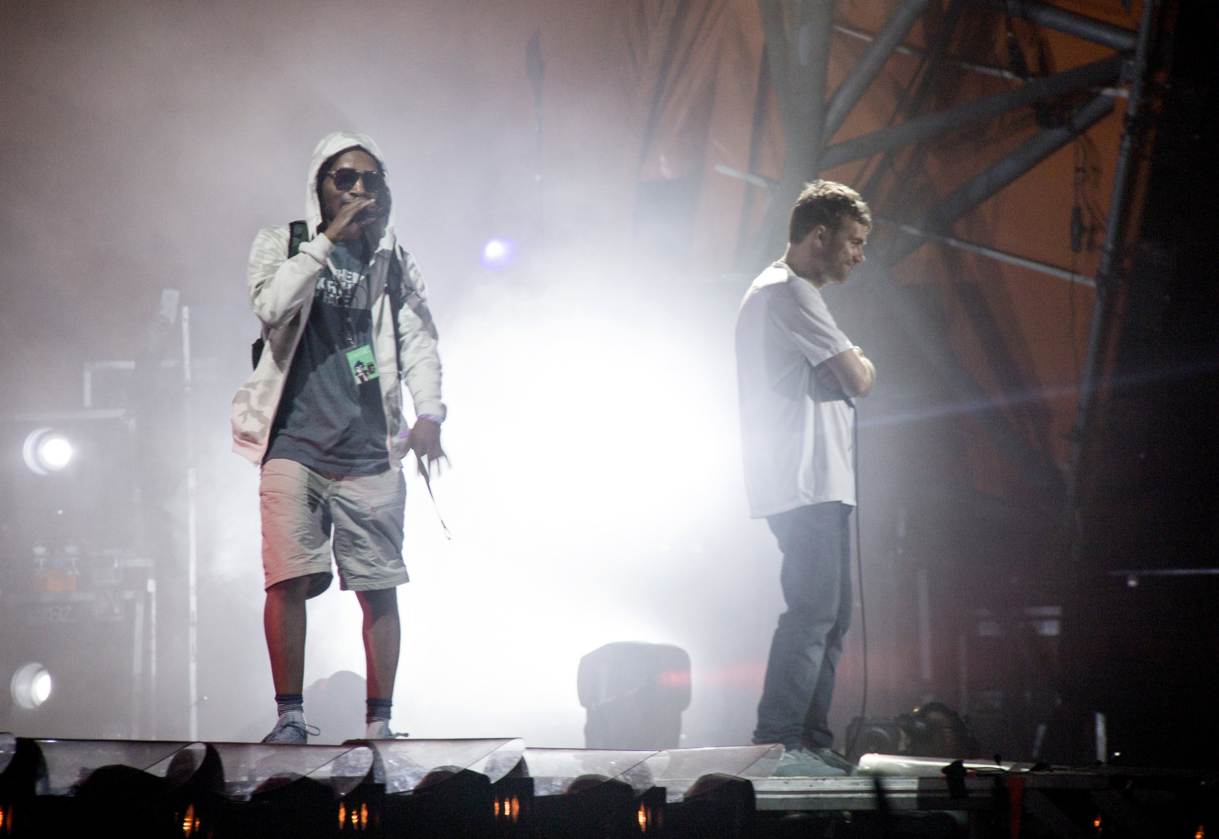 In this July 7, 2018 photo, U.S. rapper Del the Funky Homosapien walks towards the edge of the stage seconds before falling during the performance of British band Gorillaz at the Orange Stage during the Roskilde Festival in Roskilde, Denmark. (Erling Brodersen/Ritzau Scanpix via AP)