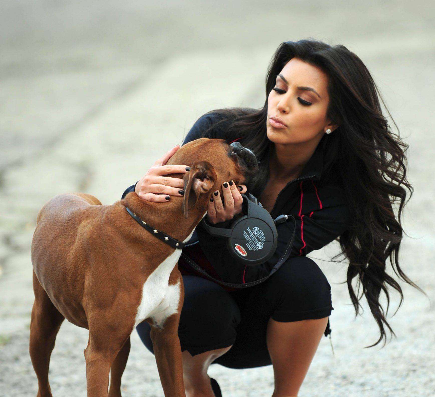 Mandatory Credit: Photo by Startraks Photo/REX/Shutterstock (1122958b) Kim Kardashian with dog Kim Kardashian with hers and Reggie Bush's Dog Rocky, Beverly Hills, Los Angeles, America - 23 Feb 2010 Kim Kardashian walks Rocky. Kim gave the dog to boyfriend Reggie Bush of the New Orleans Saints.