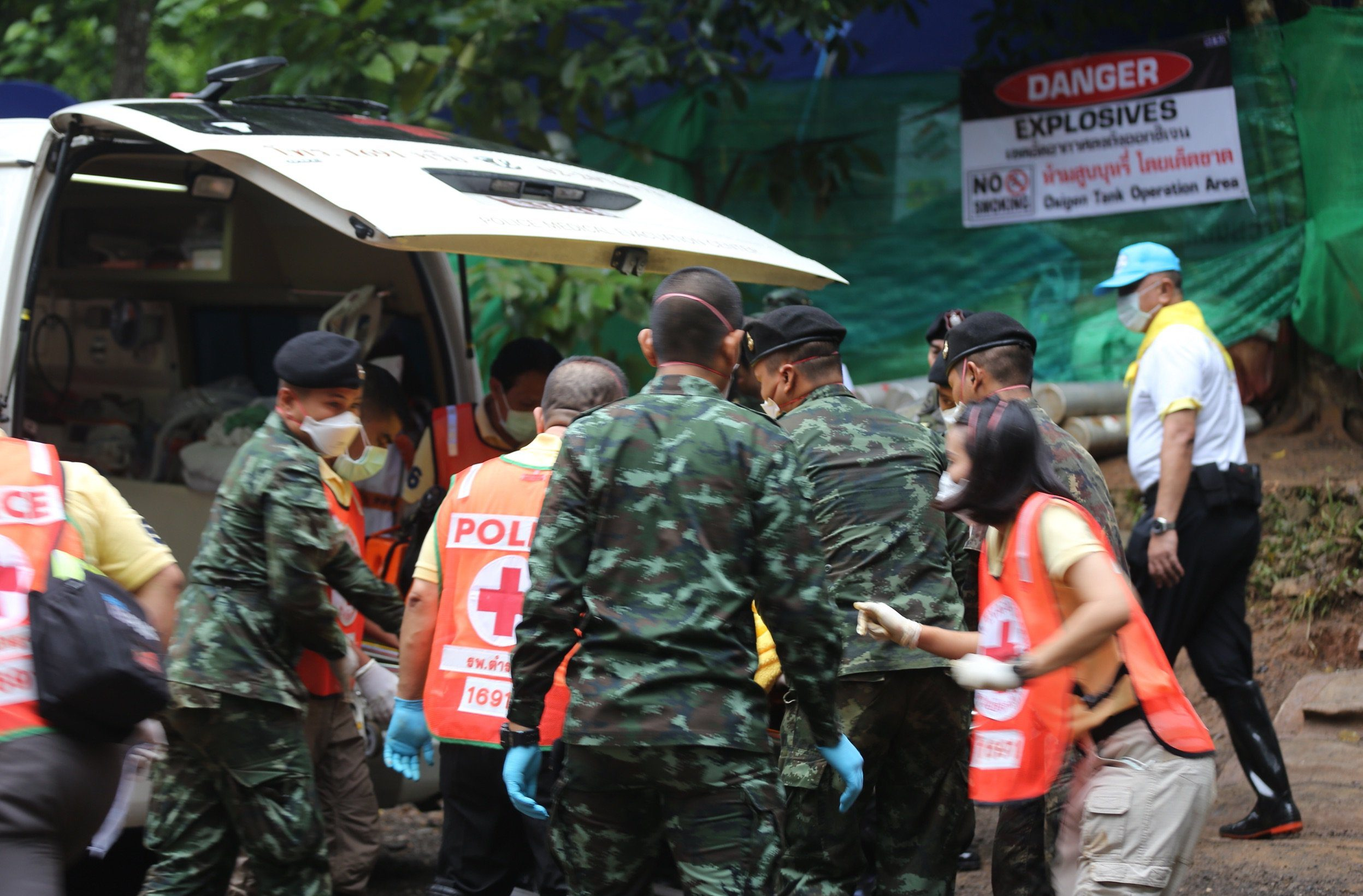 Mandatory Credit: Photo by Xinhua/REX/Shutterstock (9745650e) Rescuers transport rescued young soccer team members in Chiang Rai, Thailand Missing football team found alive in cave, Chiang Rai, Thailand - 08 Jul 2018 Four boys of 13 trapped in a northern Thailand cave have been brought out through an underwater evacuation, a member of the rescue team said on condition of anonymity Sunday.