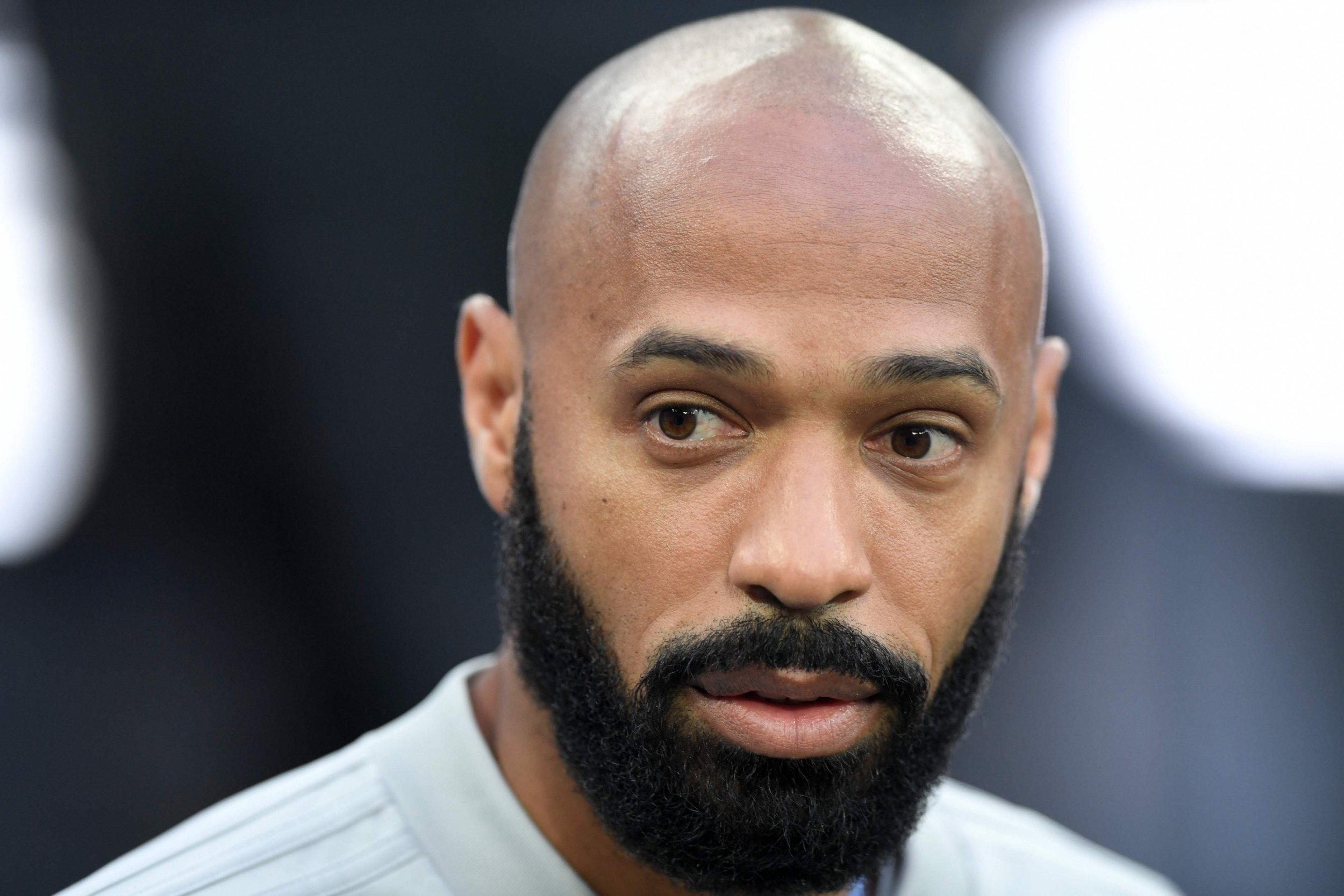 Belgium's assistant coach Thierry Henry looks on during the Russia 2018 World Cup semi-final football match between France and Belgium at the Saint Petersburg Stadium in Saint Petersburg on July 10, 2018. / AFP PHOTO / GABRIEL BOUYS / RESTRICTED TO EDITORIAL USE - NO MOBILE PUSH ALERTS/DOWNLOADS GABRIEL BOUYS/AFP/Getty Images