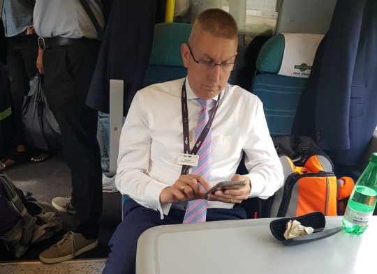 Govia Thameslink?s Head of Operations Mark Boon sits in an empty first class railway carriage of a London bound Southern Train, July 10 2018. The boss of the much criticised rail service apparently told commuters to stay out of the empty First Class carriage on a late and very packed train - while he took up two seats. According to a witness he even handed his business card out to the people that he was turning away.