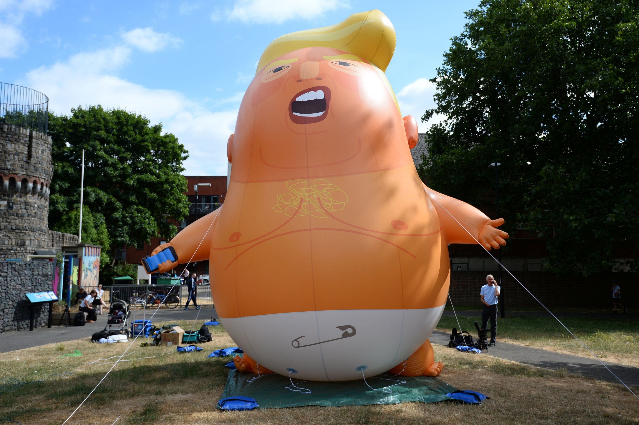 The Trump Baby Blimp is inflated during a practice test, at Bingfield Park in north London. PRESS ASSOCIATION Photo. Picture date: Tuesday July 10, 2018. The six-metre high blow-up caricature depicting Mr Trump as a baby wearing a nappy and clutching a mobile phone was given the green light by the Greater London Authority to fly near Parliament. Photo credit should read: Kirsty O'Connor/PA Wire