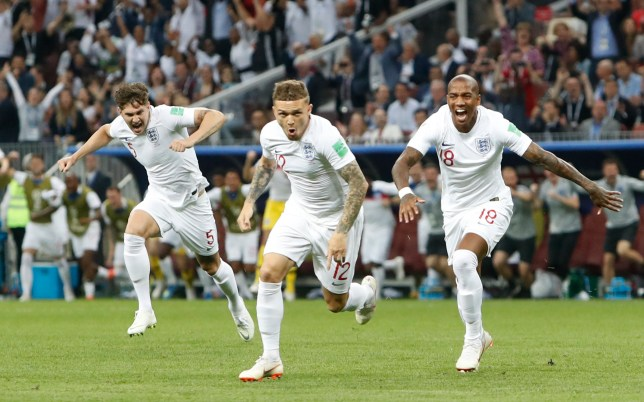 England's Kieran Trippier, centre, celebrates with Harry Kaneafter scoring the opening goal during the semifinal match between Croatia and England at the 2018 soccer World Cup in the Luzhniki Stadium in Moscow, Russia, Wednesday, July 11, 2018.(AP Photo/Alastair Grant)