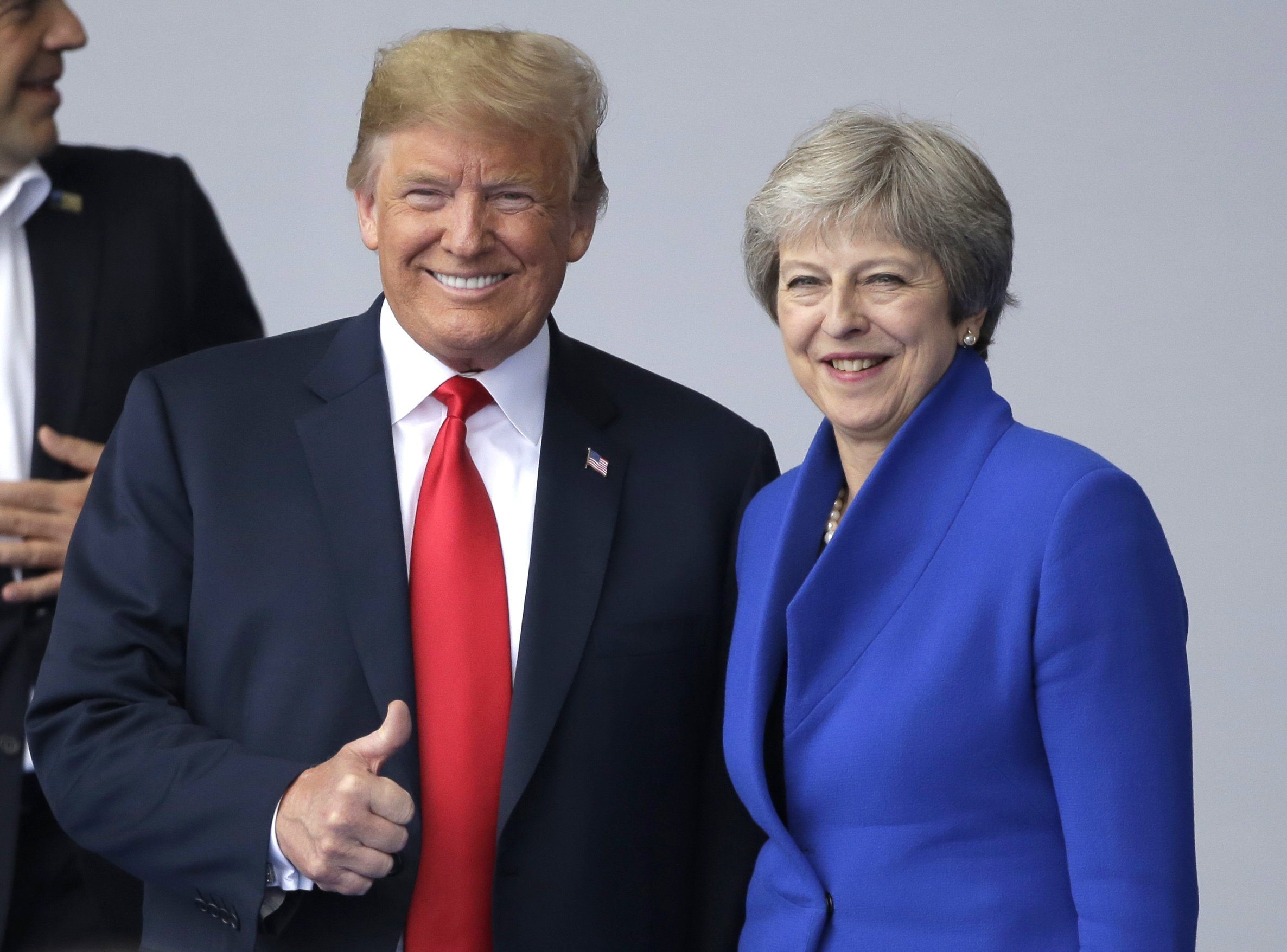 """In this July 11, 2018, photo, U.S. President Donald Trump, left, talks to British Prime Minister Theresa May during a summit of heads of state and government at NATO headquarters in Brussels. Trump is all in for Winston Churchill during his first visit to the United Kingdom as president, paying his respects to an icon of American conservatives who coined the phrase the """"special relationship."""" Trump will join May for a black-tie dinner Thursday at Blenheim Palace, Churchill's birthplace near Oxford, at the start of his trip to England. (AP Photo/Markus Schreiber)"""