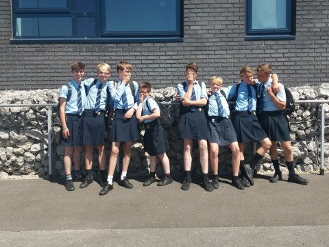 Boys wear skirts to school when shorts are banned despite 32C heat
