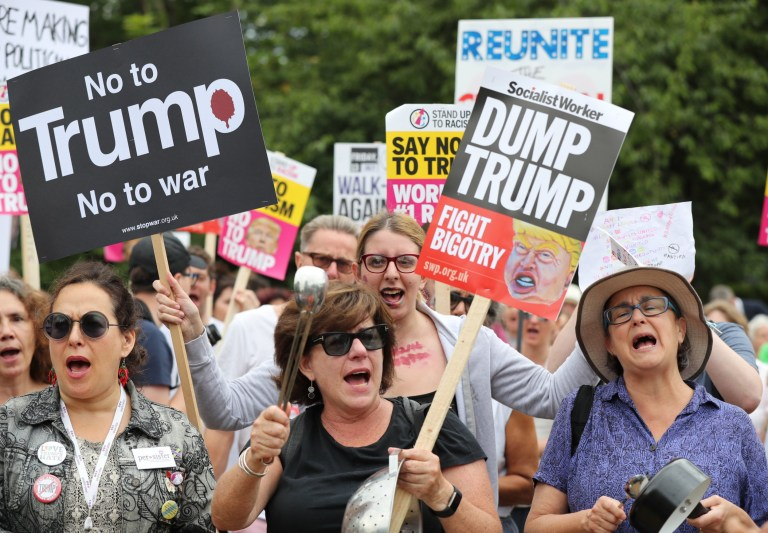Demonstrators bang pots and pans as they gather at the US ambassador residence in Regent's Park, London, as part of the protests against the visit of US President Donald Trump to the UK. PRESS ASSOCIATION Photo. Picture date: Thursday July 12, 2018. See PA story POLITICS Trump. Photo credit should read: Gareth Fuller/PA Wire