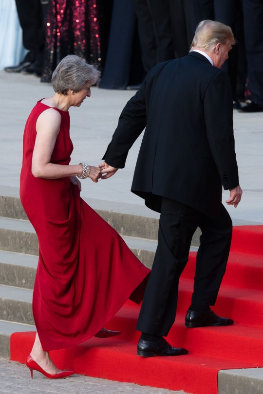 (L-R) Britain's Prime Minister Theresa May (L) walks with US President Donald Trump (R) as Trump arrives for a black-tie dinner with business leaders at Blenheim Palace, west of London, on July 12, 2018, on the first day of President Trump's visit to the UK. The four-day trip, which will include talks with Prime Minister Theresa May, tea with Queen Elizabeth II and a private weekend in Scotland, is set to be greeted by a leftist-organised mass protest in London on Friday. / AFP PHOTO / POOL / WILL OLIVERWILL OLIVER/AFP/Getty Images