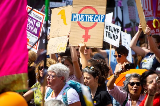 Feminist marchers gather in Portland Place outside the BBC to march against visiting Americqan President Donald Trump whose reported misogynist views are widely reviled by feminists. London, July 13 2018.