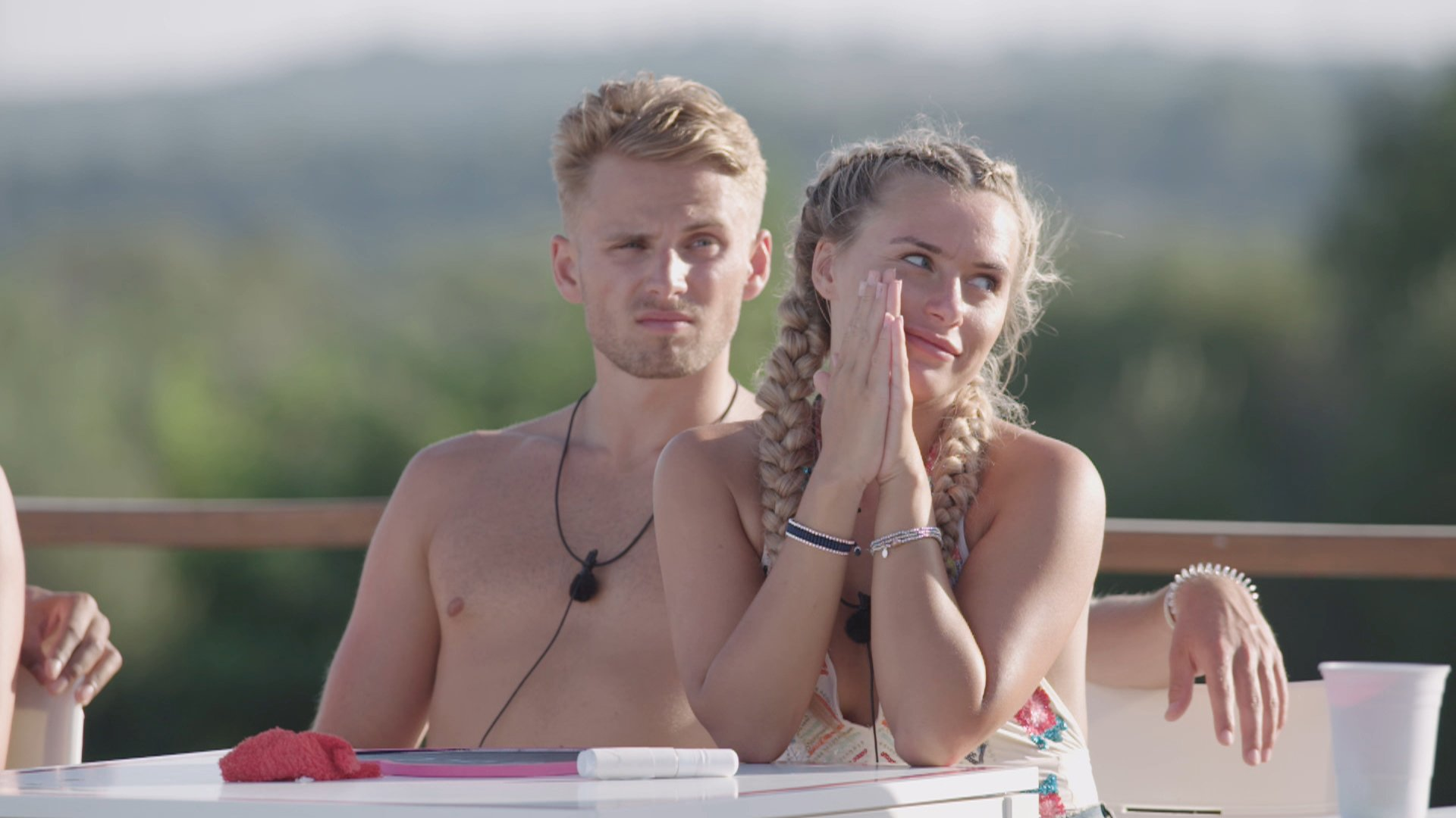 From ITV Studios Love Island: SR4: Ep40 on ITV2 Pictured: Charlie and Ellie during the Twitter challenge. This photograph is (C) ITV Plc and can only be reproduced for editorial purposes directly in connection with the programme or event mentioned above, or ITV plc. Once made available by ITV plc Picture Desk, this photograph can be reproduced once only up until the transmission [TX] date and no reproduction fee will be charged. Any subsequent usage may incur a fee. This photograph must not be manipulated [excluding basic cropping] in a manner which alters the visual appearance of the person photographed deemed detrimental or inappropriate by ITV plc Picture Desk. This photograph must not be syndicated to any other company, publication or website, or permanently archived, without the express written permission of ITV Plc Picture Desk. Full Terms and conditions are available on the website www.itvpictures.co.uk For further information please contact: james.hilder@itv.com / 0207 157 3052
