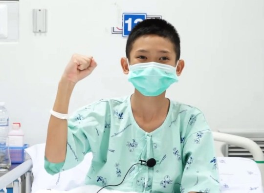 epa06887199 A handout photo made available by the Chiang Rai Prachanukroh Hospital and the Ministry of Public Health shows one of the 13 rescued soccer team members, Mongkol Boonpiam, nicknamed 'Mark', speaking via video clip from his hospital bed in Chiang Rai province, Thailand, 14 July 2018. Thirteen members of a Thai soccer team, including their assistant coach, were rescued from Tham Luang cave after being trapped for nearly two weeks. EPA/PUBLIC HEALTH MINISTRY / HANDOUT HANDOUT EDITORIAL USE ONLY/NO SALES HANDOUT EDITORIAL USE ONLY/NO SALES
