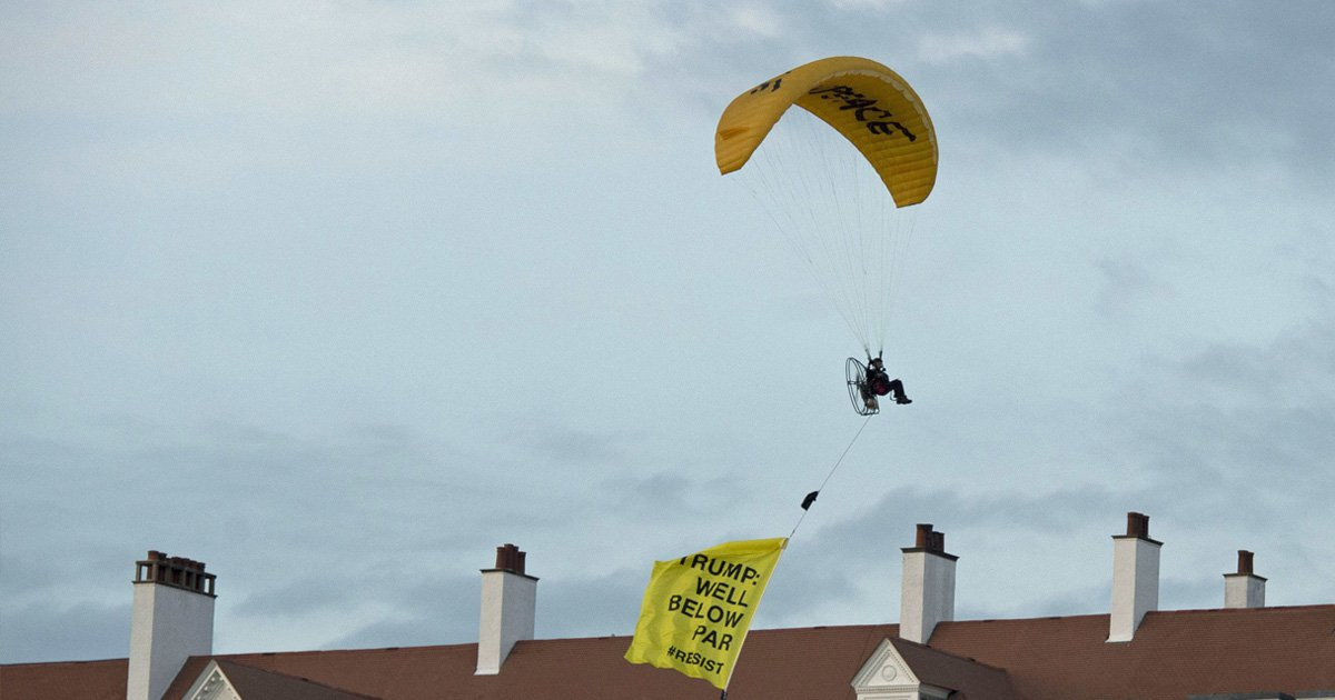 "A Greenpeace protester flying a microlight passes over Donald Trump's resort in Turnberry, South Ayrshire, with a banner reading ""Trump: Well Below Par"", shortly after the US President arrived at the hotel. PRESS ASSOCIATION Photo. Picture date: Friday July 13, 2018. See PA story POLITICS Trump. Photo credit should read: John Linton/PA Wire"