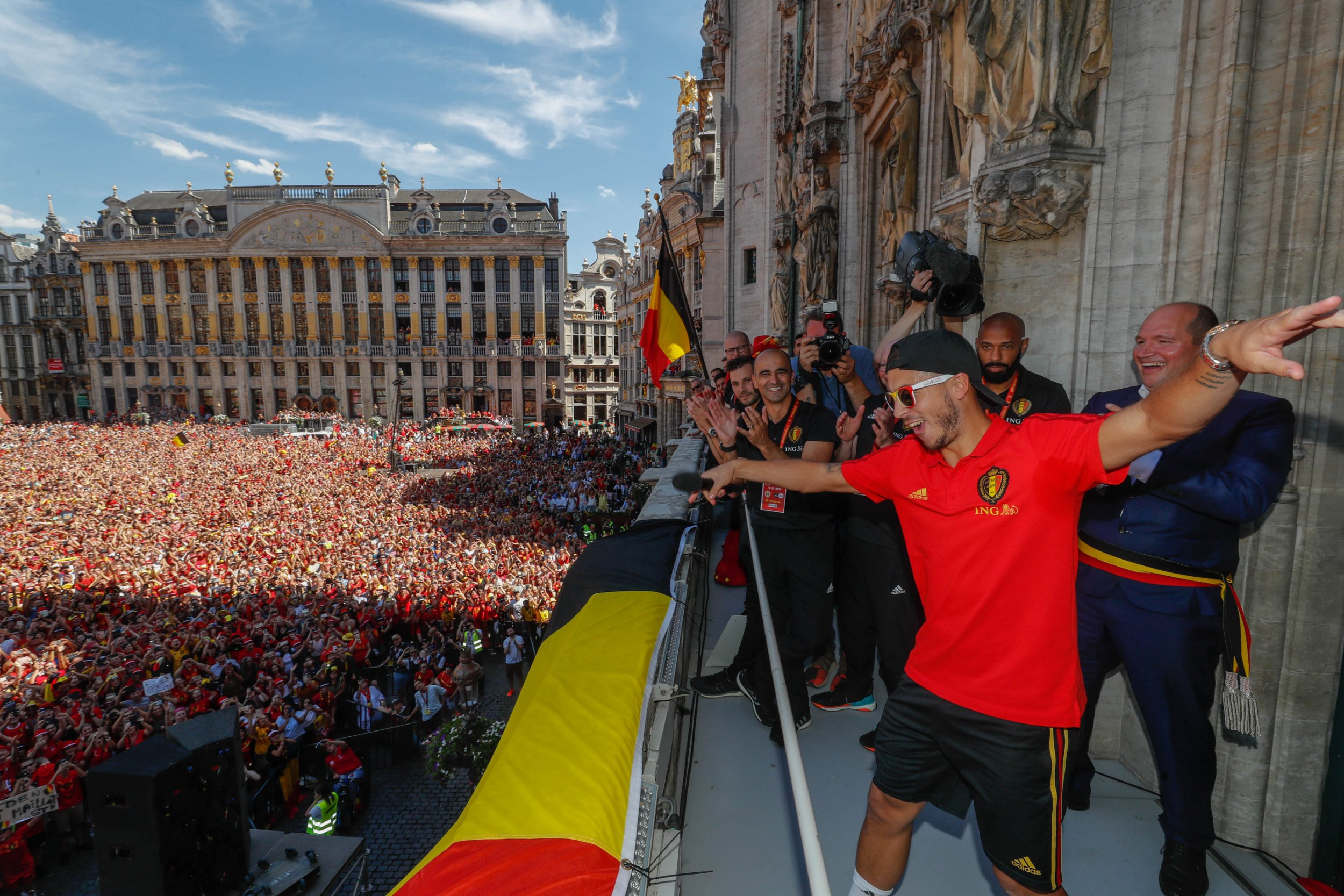 BRUSSEL, BELGIUM - JULY 15: Belgian soccer team player Eden Hazard celebrates on the balcony of the city hall at the Brussels' Grand Place, after taking the third place in the World Cup 2018 on July 15, 2018 in Brussels, Belgium. (Photo by Yves Herman/Royal Belgium Pool/Getty Images)