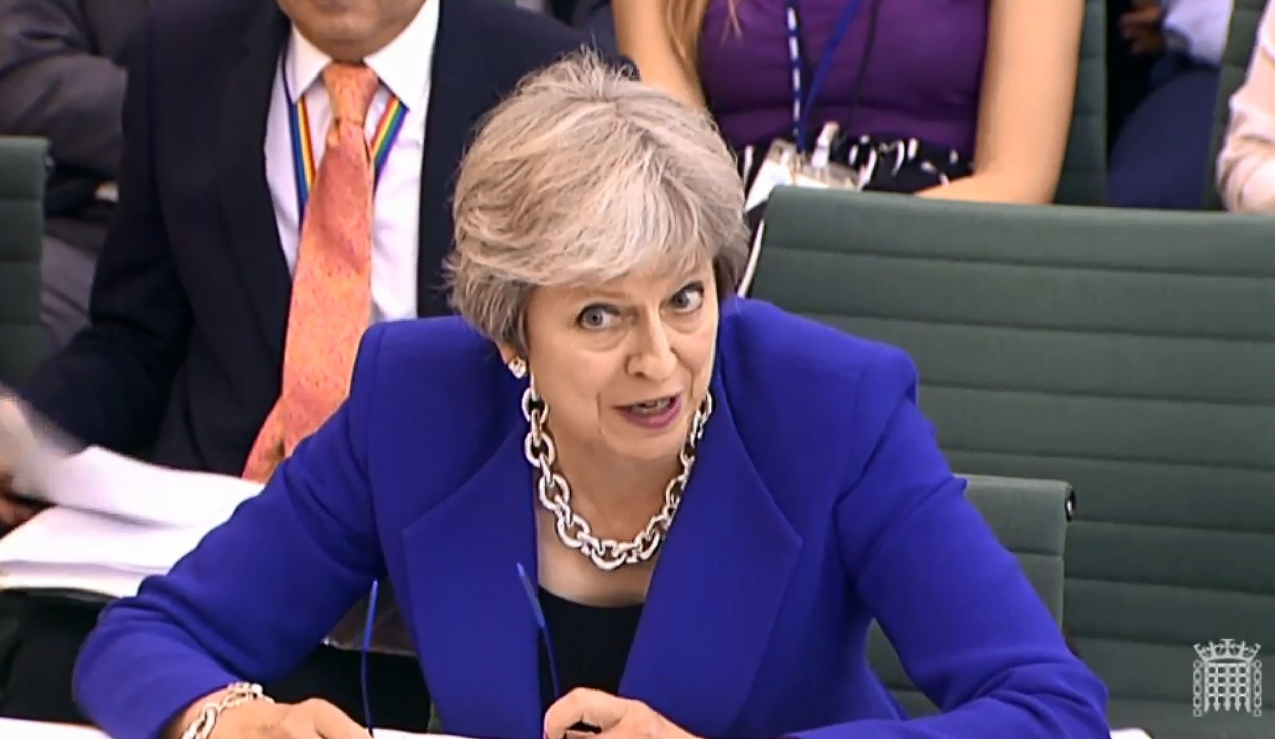 """A video grab from footage broadcast by the UK Parliament's Parliamentary Recording Unit (PRU) shows Britain's Prime Minister Theresa May as she speaks before the Liaison Commitee in the House of Commons in London on July 18, 2018. / AFP PHOTO / PRU AND AFP PHOTO / HO / RESTRICTED TO EDITORIAL USE - MANDATORY CREDIT """" AFP PHOTO / PRU """" - NO USE FOR ENTERTAINMENT, SATIRICAL, MARKETING OR ADVERTISING CAMPAIGNSHO/AFP/Getty Images"""