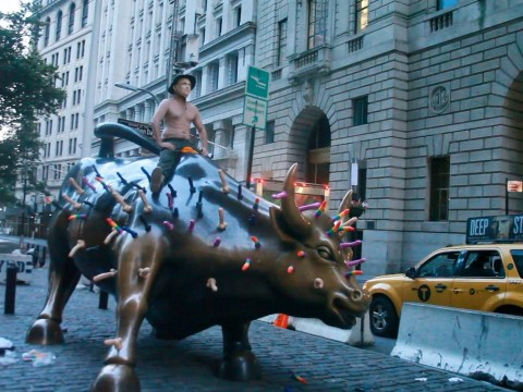 Wall Street bull covered in dildos in protest against Vladimir Putin