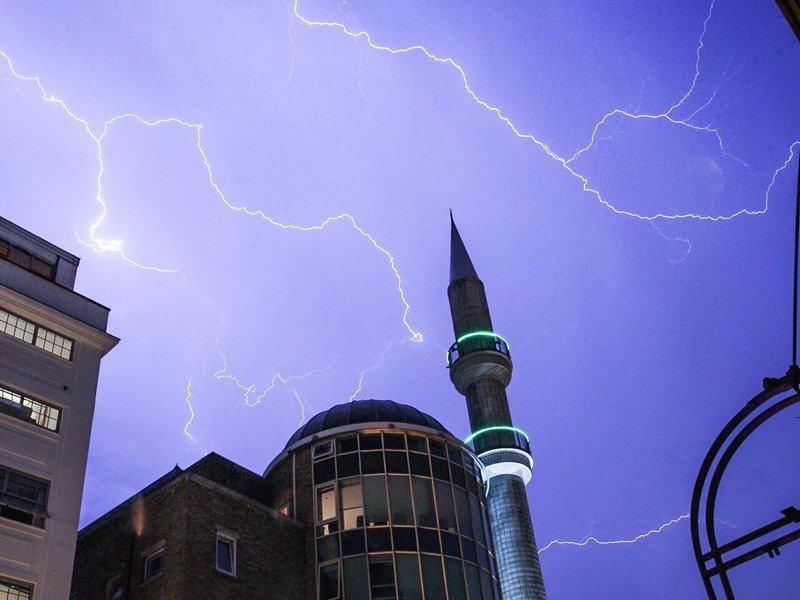 Handout photo taken from Twitter with permission from Andrew Lanxon Hoyle/@Batteryhq of lightning over the the Suleymaniye Mosque in Dalston, east London on Saturday. PRESS ASSOCIATION Photo. The Met Office issued a yellow warning of thunderstorms and torrential rain for much of the south of England and Wales throughout Saturday and Sunday. See PA story WEATHER BankHoliday Photo credit should read: Andrew Lanxon Hoyle/@Batteryhq/PA Wire NOTE TO EDITORS: This handout photo may only be used in for editorial reporting purposes for the contemporaneous illustration of events, things or the people in the image or facts mentioned in the caption. Reuse of the picture may require further permission from the copyright holder.