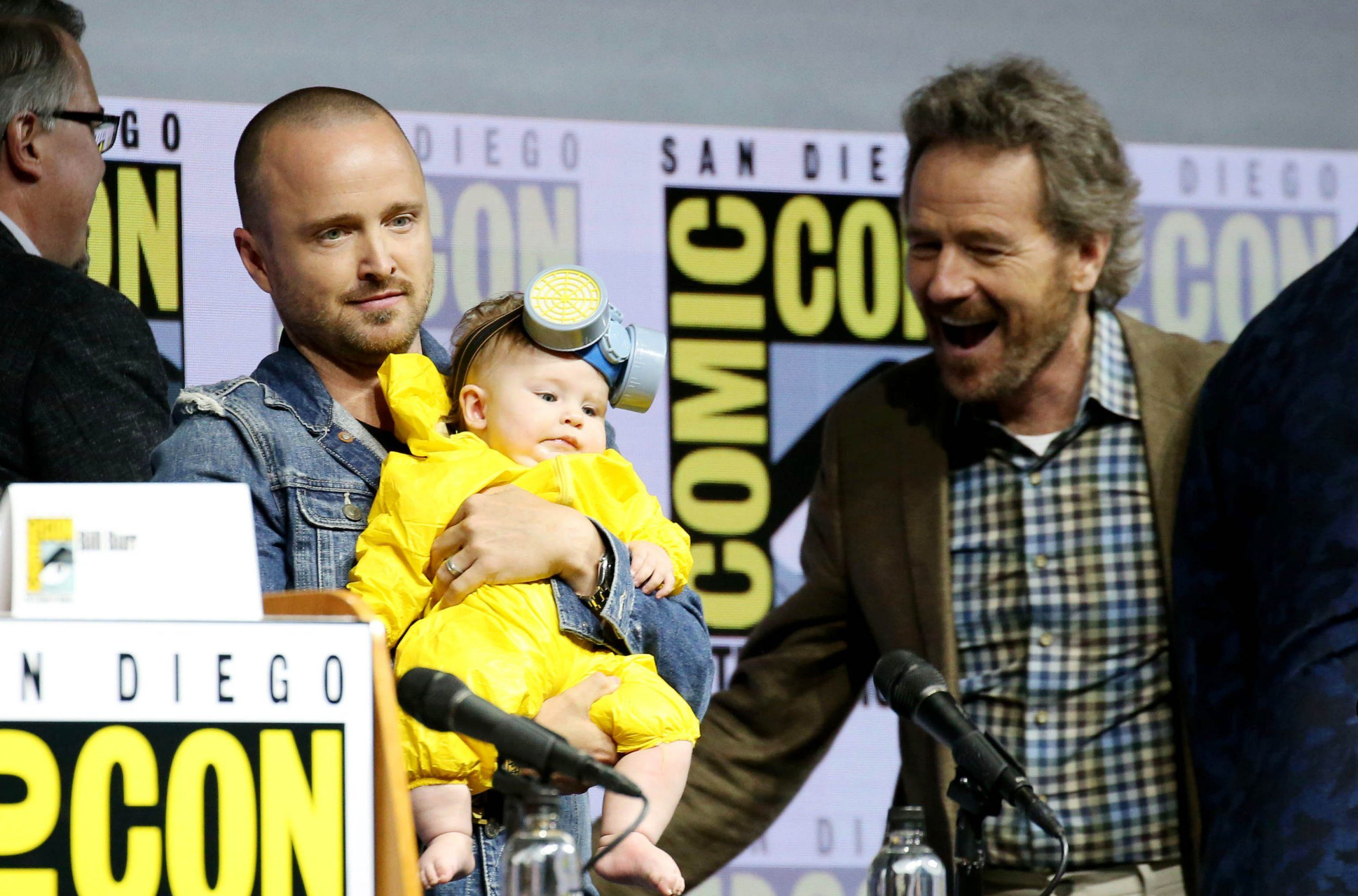 Aaron Paul brings his baby daughter to Comic Con as a little Heisenberg – as Breaking Bad cast discuss on-screen reunions