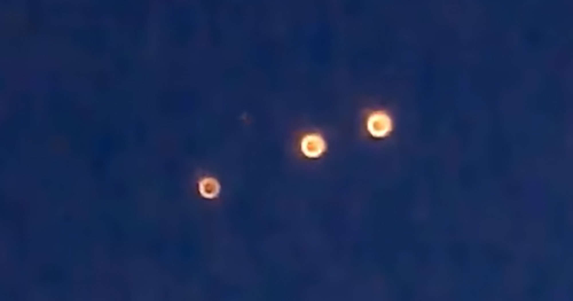 "Pic shows: The UFO orbs seen in the sky;Videos going viral on Chinese social media with more than 5 million views appear to have captured a series of unidentified flying objects slowly crawling across the sky.Three orbs of light moving in an eerie linear motion were first captured above the municipality of Chongqing in south-western China, but the UFOs have also been sighted in the country???s northwest and even as far as in the eastern city of Shanghai and Fujian province.Local residents and social media users have been commenting in their thousands while trying to work out the origin of the lights, which some believed to be LED bulbs on a kite or sky lanterns.Footage taken at different times across China show the same sort of lights appearing around dusk and continuing into the night.The glowing orbs follow one another across the sky while seemingly making no sound and leaving no other evidence of their destination or where they came from.Given the widespread nature of the sightings, members of the public have surmised that it is a nationwide event.And because the Chinese government has so far been mute about the UFOs, netizens have not ruled out the possibility of it being an alien invasion.Social media user ???E-248??? wrote: ""Being the world???s second largest economy pays off! The aliens are finally giving us the recognition we deserve. They only ever visited the United States in the past.""???Chenghui??? wrote: ""The government hasn???t thought of how they???re going to explain this one yet."""