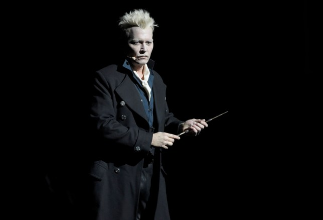 "Johnny Depp appears in character as Gellert Grindelwald at the Warner Bros. Theatrical panel for ""Fantastic Beasts: The Crimes of Grindelwald"" on day three of Comic-Con International on Saturday, July 21, 2018, in San Diego. (Photo by Chris Pizzello/Invision/AP)"