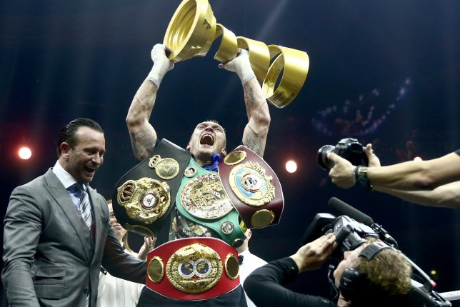 MOSCOW, RUSSIA - JULY 21, 2018: WBC/WBO champion Oleksandr Usyk (C) of Ukraine, celebrates winning his WBSS (World Boxing Super Series) cruiserweight final bout against WBA/IBF champion Murat Gassiev of Russia, at Moscow's Olympiyskiy Arena. Valery Sharifulin/TASS (Photo by Valery Sharifulin\TASS via Getty Images)