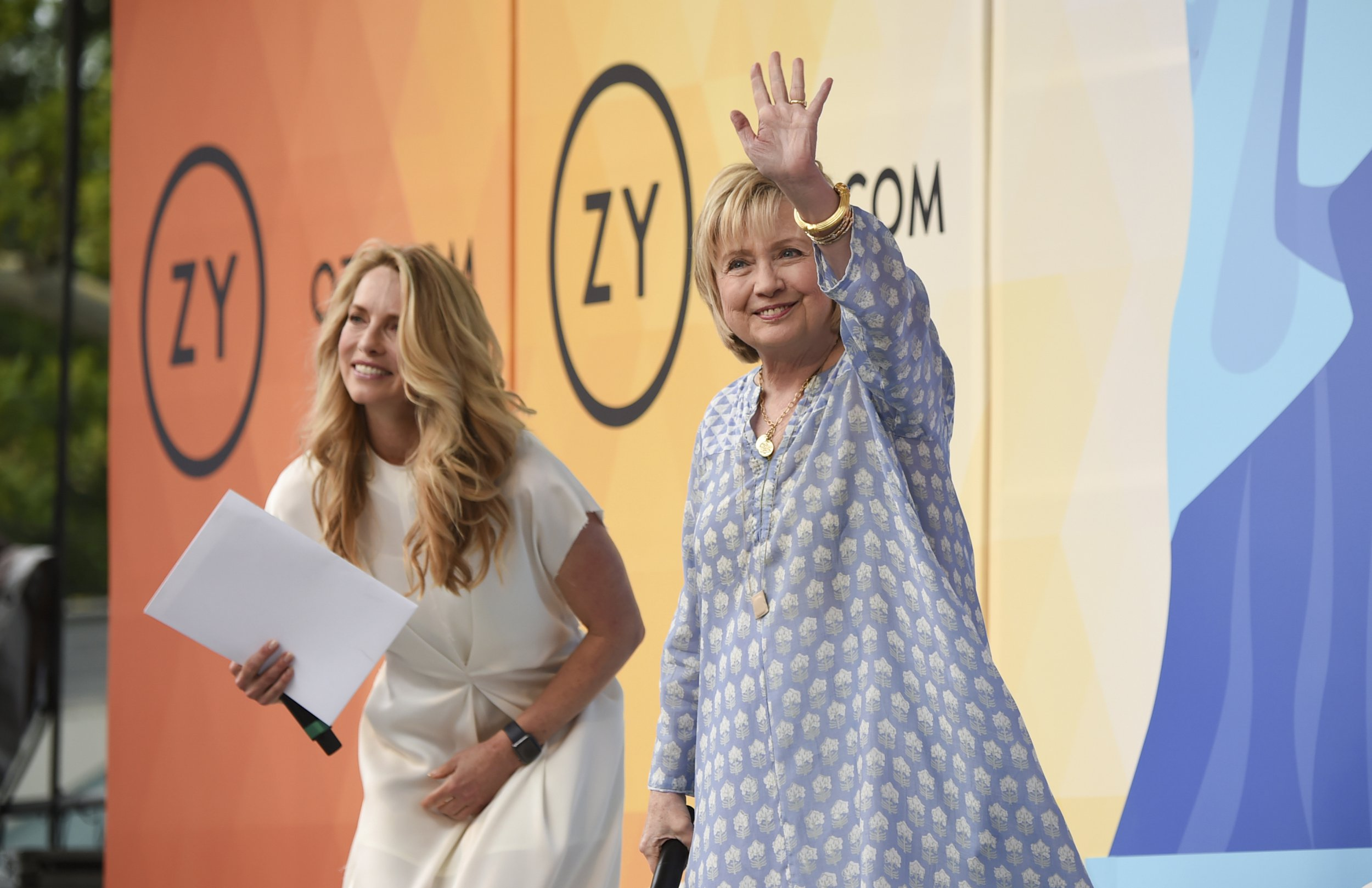 Democratic presidential candidate and former Secretary of State Hillary Rodham Clinton, right, waves to the crowd before a conversation with Laurene Powell Jobs at OZY Fest in Central Park on Saturday, July 21, 2018, in New York. (Photo by Evan Agostini/Invision/AP)