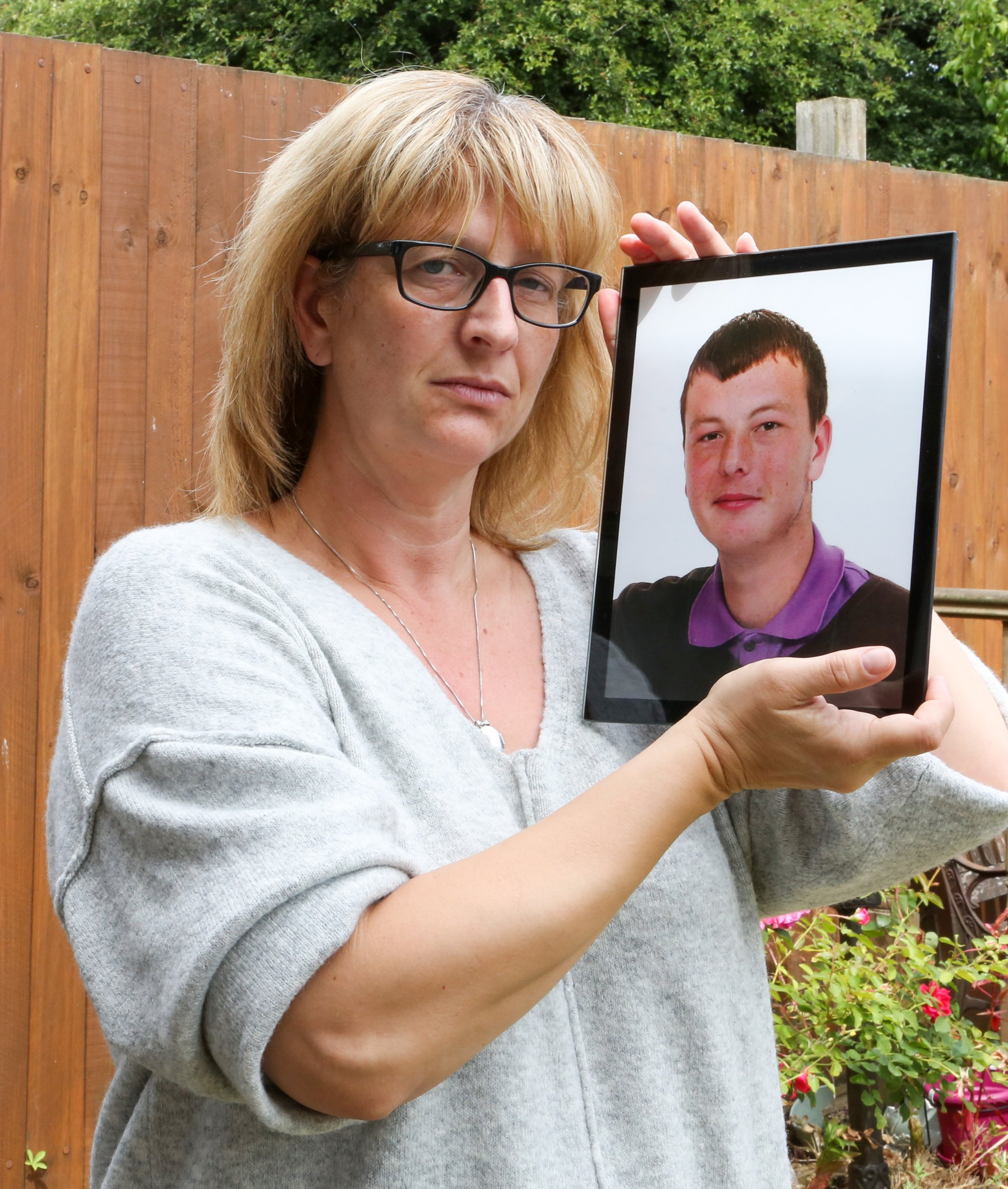 ***Embargoed until 1pm 22nd July 2018*** Online usage fee ?150 per picture. Online Set fee ?400. Print fee ?250 per photo.***Notice Please Read Rights Usage Terms; Pic Shows : Helen Godden at her home in Ramsgate in Kent With the shrine for her autistic son Carl who was killed in a row over a Facebook Post.