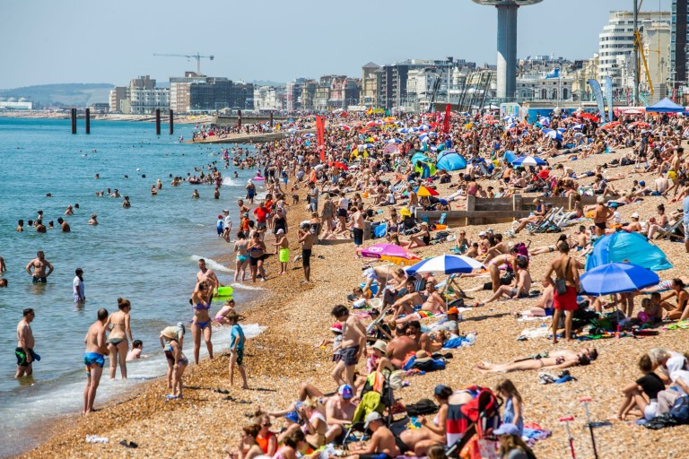 Mandatory Credit: Photo by Hugo Michiels/LNP/REX/Shutterstock (9731850ae) Thousands of visitors take to the beach in Brighton and Hove as sunny and hot weather is hitting the seaside resort. Seasonal weather, Brighton, UK - 30 Jun 2018