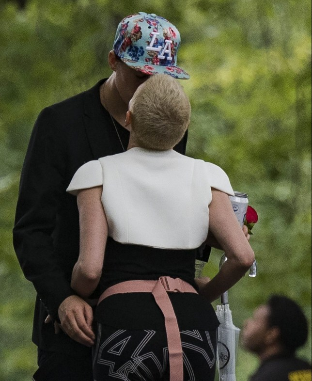 ** RIGHTS: WORLDWIDE EXCEPT IN BELGIUM, FRANCE, GERMANY, NETHERLANDS, POLAND, SPAIN ** New York, NY - *EXCLUSIVE* - Rose McGowan is spotted relaxing after her speech at OZY festival in Central Park. It seems she has found love again as she is spotted kissing a mystery man several times. The man, who has been spotted prior with her, was seen holding a red rose whole time, and also he gave a drink to Rose. The actress seems to forget the park rules as she was drinking and smoking but the security officer was escorting her didn't seem to mind. Fans approached the 'Charmed' and '90210' star, who happily greeted and chatted back. Pictured: Rose McGowan BACKGRID USA 22 JULY 2018 BYLINE MUST READ: Skyler2018 / BACKGRID USA: +1 310 798 9111 / usasales@backgrid.com UK: +44 208 344 2007 / uksales@backgrid.com *UK Clients - Pictures Containing Children Please Pixelate Face Prior To Publication*