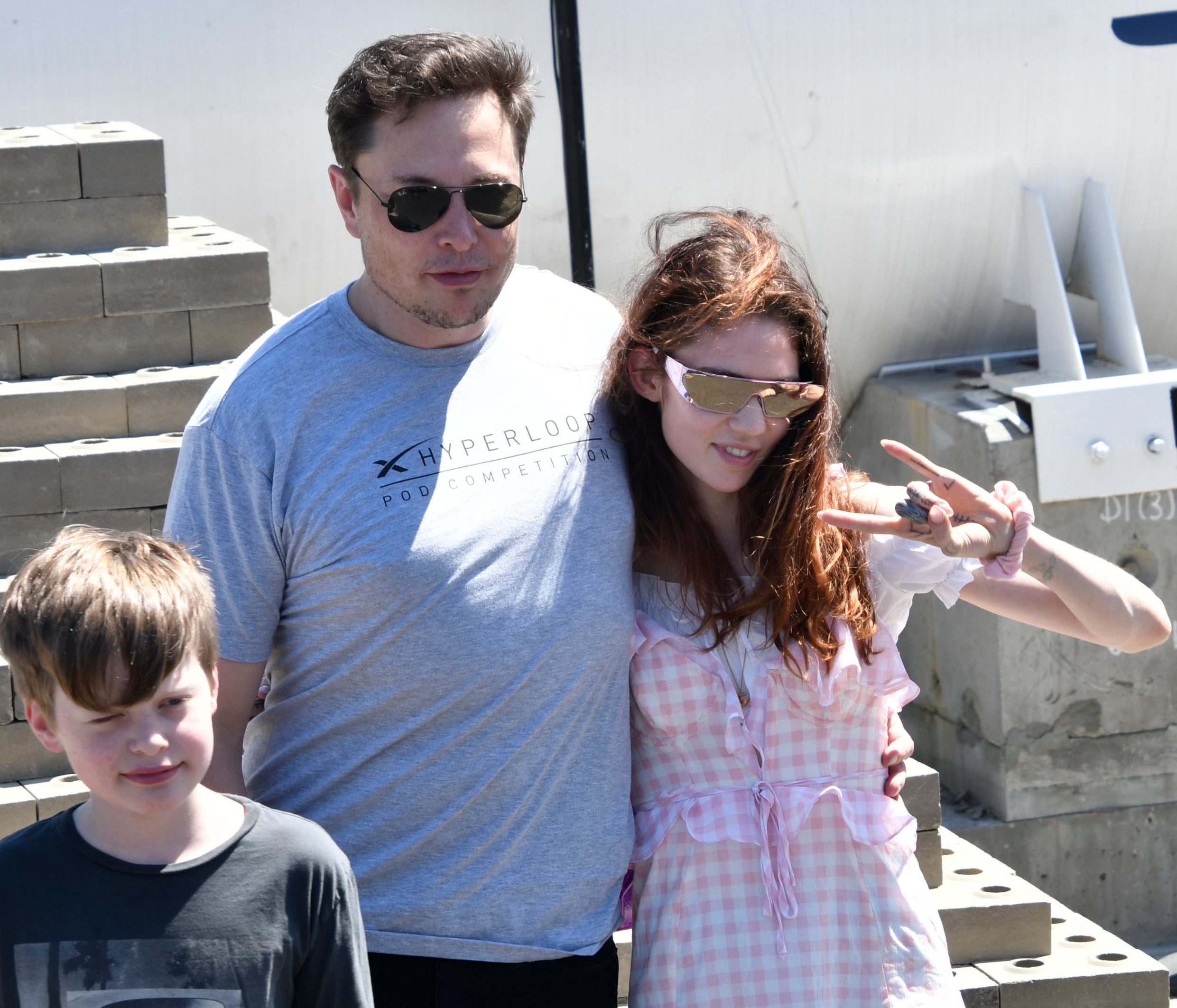 Mandatory Credit: Photo by Gene Blevins/ZUMA Wire/REX/Shutterstock (9767924j) SpaceX CEO Elon Musk with his new girlfriend singer Grimes pose together as the last of 4 teams of students comprised of over 600 competitors from more than 40 countries around the world compete in Hawthorne, California, to showcase their pods at SpaceX??s third Hyperloop Pod Competition Sunday. The winning team was WARR Hyperloop, as they hit speeds of 284 mph today. Hyperloop Pod Competition, Hawthorne, USA - 22 Jul 2018