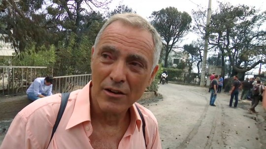 In this image taken from video, Nikos Stavrinidis gives a dramatic account of how he escaped from Greek forest fire, in Mati, near Athens, Tuesday July 24, 2018. Stavrinidis said he fled from the fire, swimming into the sea and choking smoke only to get swept away by the current into the sea, and then he was rescued by a fishing boat. (AP Photo)