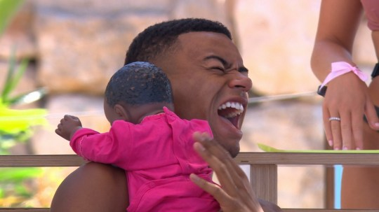 From ITV Studios Love Island: SR4: Ep52 on ITV2 Pictured: Wes holding the baby. This photograph is (C) ITV Plc and can only be reproduced for editorial purposes directly in connection with the programme or event mentioned above, or ITV plc. Once made available by ITV plc Picture Desk, this photograph can be reproduced once only up until the transmission [TX] date and no reproduction fee will be charged. Any subsequent usage may incur a fee. This photograph must not be manipulated [excluding basic cropping] in a manner which alters the visual appearance of the person photographed deemed detrimental or inappropriate by ITV plc Picture Desk. This photograph must not be syndicated to any other company, publication or website, or permanently archived, without the express written permission of ITV Plc Picture Desk. Full Terms and conditions are available on the website www.itvpictures.co.uk For further information please contact: james.hilder@itv.com / 0207 157 3052