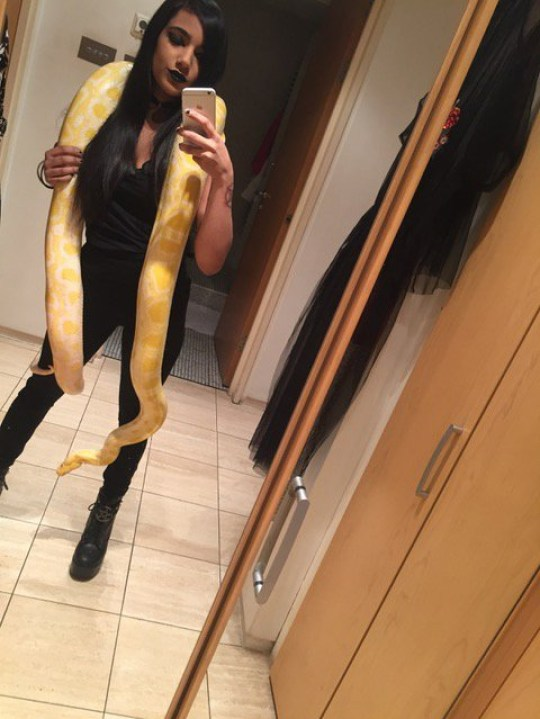 *** EXCLUSIVE - VIDEO AVAILABLE *** LONDON, UNITED KINGDOM - UNDATED: Zee takes a selfie with one of her constrictors in London, England. An animal lover has turned her small London flat into a secluded paradise for her collection of snakes, including a 16 foot Burmese python. Zee, 21, who is training to be a veterinary nurse, first saw a snake at six-years-old and has been obsessed with them ever since. At 14-years-old, she split the price of her first snake with her brother before bringing it home to her mum, who quickly had to get used to the idea of living in a mini reptile house. Now the animal lover has collected 16 snakes, including her majestic Burmese python, who likes to slither around the hallways to relax, a boa constrictor, royal python and a blood python. PHOTOGRAPH BY Barcroft Images