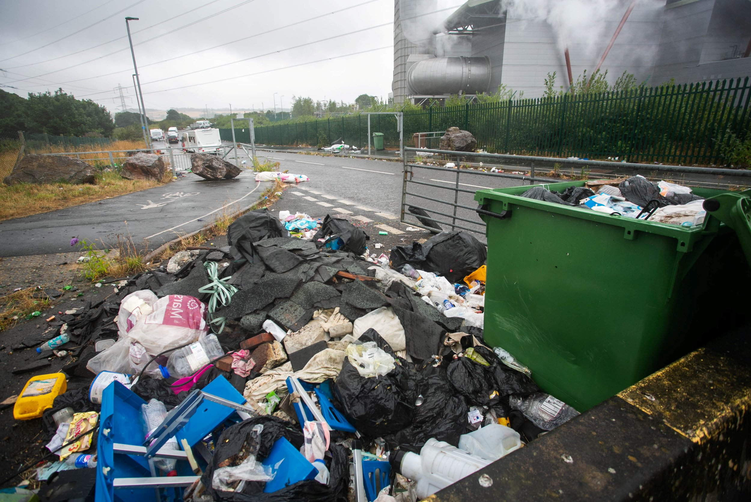 Travellers in Holland Road in Plympton, Devon, are complaining about the litter in the street and think the council should clean up. 27/07/2018 See SWNS story SWLITTER; Travellers who have set up camp next to the Langage power station say they will be gone by the weekend ??? but think the council should clean up first. Several caravan and large vehicles have parked up in Holland Road in Plympton after a number of illegal encampments around Plymouth were given their marching orders. Plymouth Live spoke to a number of the travellers on Thursday morning who said they only intended to stay for a few days.