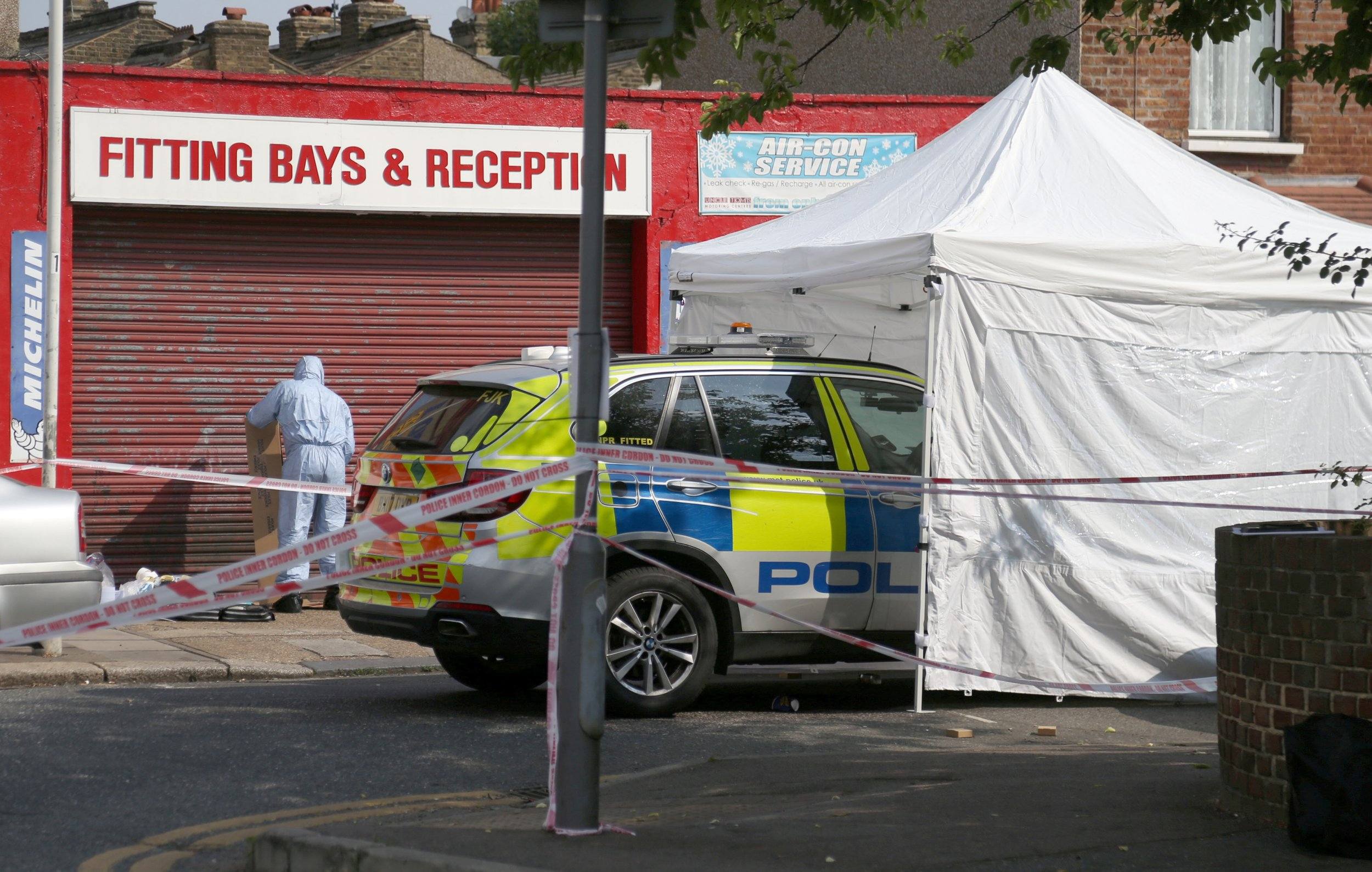 """Police and forensic officers on the scene at Bective Road, Forest Gate, London 27 July 2018 .,following a shootout. Armed police were in a shootout with three men following a car chase in east London. Three people have been arrested on suspicion of attempted murder after shots were fired towards officers. Police were called to Lascelles Close in Leytonstone at 10.45pm on Thursday to reports of suspects seen with a gun. Armed officers attended the scene and, a short time later, a vehicle was seen nearby which failed to stop for officers. The suspects were arrested in Bective Road, Forest Gate, more than a mile away from where officers were initially called. Scotland Yard said """"a number of shots were fired towards officers"""" during a pursuit, and police also fired weapons."""