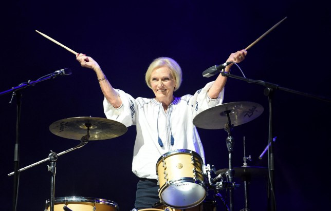 Mandatory Credit: Photo by Finbarr Webster/REX/Shutterstock (9772130az) Mary Berry makes a surprise entance on drums and performs with Rick Astley Camp Bestival, Dorset, UK - 27 Jul 2018