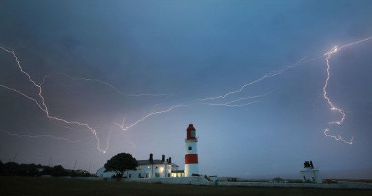 Lightning flashes over Souter lighthouse in South Shields as heavy thunderstorms marked the end of the UK heatwave on Friday. PRESS ASSOCIATION Photo. Picture date: Friday July 27, 2018. See PA story WEATHER Hot. Photo credit should read: Owen Humphreys/PA Wire