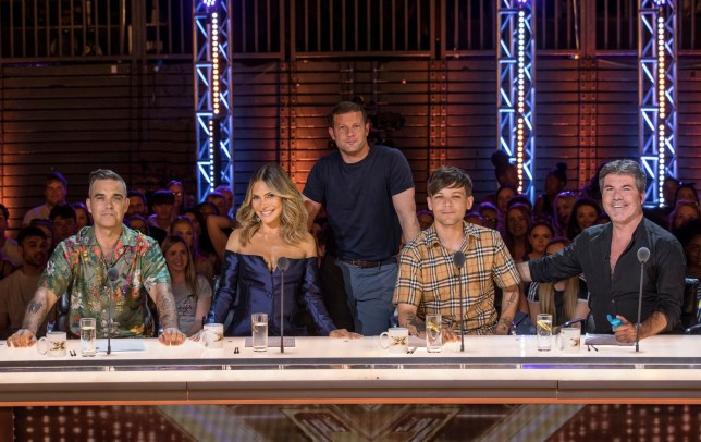 Editorial Use Only Mandatory Credit: Photo by Dymond/Thames/Syco/REX/Shutterstock (9767708a) Robbie Williams, Ayda Williams, Louis Tomlinson, Simon Cowell and Dermot O'Leary (behind) 'The X Factor' TV show, Judges, Series 15, London, UK - 22 Jul 2018