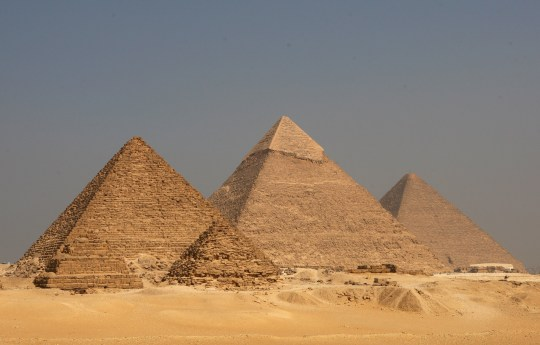 CAIRO, EGYPT - OCTOBER 11: A general view of the Pyramids at the Giza Plateau. From left to right is the Pyramid of Menkaure, the Pyramid of Khafre and the Great Pyramid for King Khufu at Giza on October 11, 2009 in Cairo, Egypt. (Photo by Alex Livesey - FIFA/FIFA via Getty Images)