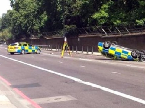 Police car flips over chasing moped near Buckingham Palace