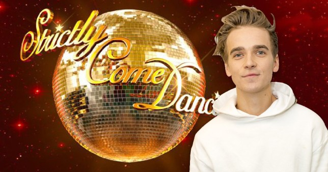 Joe Sugg stands in front of Strictly logo (Picture: BBC/Rex)