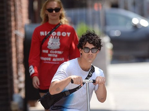 Joe Jonas shows off in front of fiancée Sophie Turner as he rolls around town on a scooter on his 29th birthday