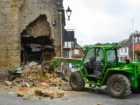 Thieves use stolen tractor to bulldoze wall and steal cash machine